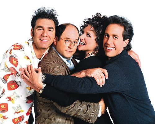 The cast of Seinfeld again in front of the screen